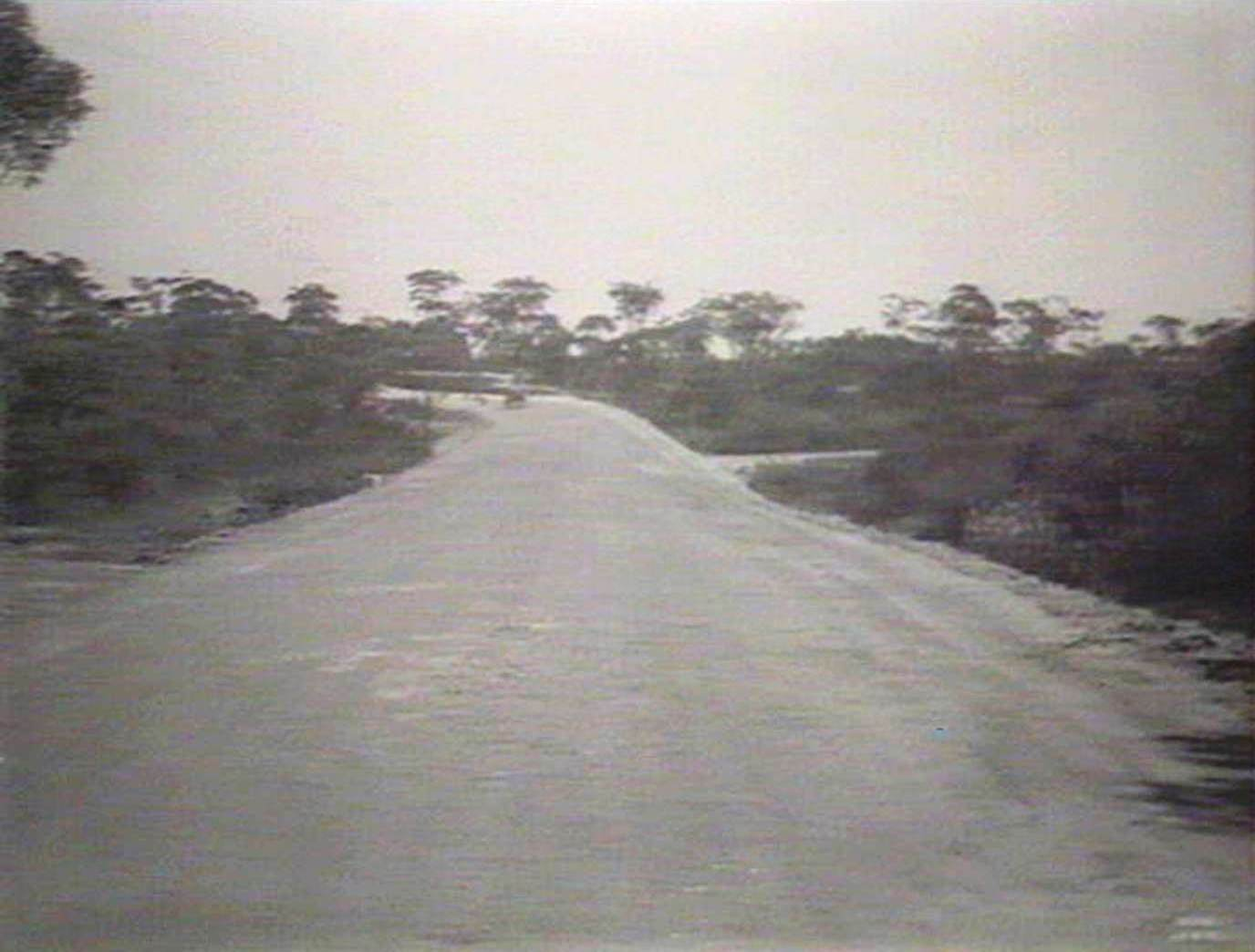 f8d23130f Pittwater Rd after construction looking towards Pacific Highway August  1935. Image No.  d1 21454h